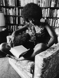 Singer Natalie Cole Relaxing with a Book, 1973 Photographic Print by Isaac Sutton