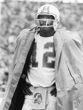 Doug Williams Cloaked in Ranincoat, 1979 Photographic Print by Vandell Cobb