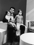 Muhammad Ali with Twin Daughters Jamillah and Rasheda, 1974 Photographic Print by Isaac Sutton