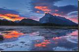 Mount Rundle Reflected in Vermillion Lake Stretched Canvas Print by Mike Grandmaison