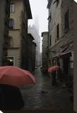 Volterra, Red Umbrellas Stretched Canvas Print by Richard Desmarais