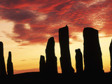 Megaliths at Sunset, Callanish, Scotland Photographic Print by Frans Lanting