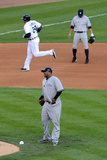 Detroit, MI - Oct. 18: Detroit Tigers v New York Yankees - CC Sabathia and Miguel Cabrera Photographic Print by Jason Miller