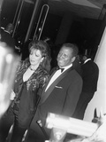 Sidney Poitier and Jackie Collins - 1990 Photographic Print by Isaac Sutton
