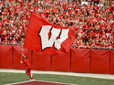 University of Wisconsin: Wisconsin Flag Flys by the Sea of Red Photographic Print