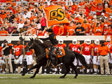Oklahoma State University: OSU Flag Flys in Boone Pickens Stadium Photographic Print
