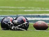 Houston Texans - Sept 9, 2012: Houston Texans Helmet and Football Fotografisk trykk av David J. Phillip