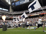 Houston Texans - Sept 9, 2012: T-E-X-A-N-S Flags Photographic Print by David J. Phillip