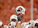 University of Wisconsin: Wisconsin Helmet Held High Photographic Print