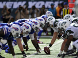 New York Jets - Sept 9, 2012: Bills Defensive Line Photographic Print by Bill Kostroun
