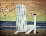 Reading on the Beach Print on Canvas by Karen J. Williams