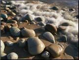 Water Washes up on Smooth Stones Lining a Beach Mounted Photo by Michael S. Lewis
