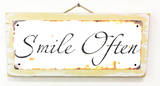 Smile Often Rusted Wood Sign