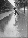 Man crossing puddle on chairs, 1934 Stretched Canvas Print