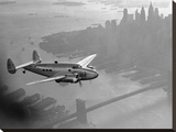 Airplane above Manhattan, 1938 Stretched Canvas Print