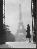 Woman looking toward Eiffel Tower Stretched Canvas Print by H. Armstrong Roberts