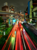 Zipping Through Tokyo Stretched Canvas Print by Trey Ratcliff