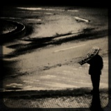 A Single Figure Standing Alone with an Umbrella Photographic Print by Eudald Castells