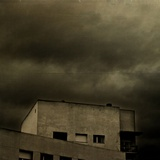 Dark Clouds over a Modern Building Photographic Print by Eudald Castells