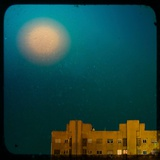 The Moon Shining in a Blue Sky over a Block of Flats Photographic Print by Eudald Castells