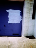 An Blue Urban Garage Door with White Paint Photographic Print by Jason Martin