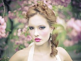 Beautiful Young Woman in a Blurred-Out Fantasy Floral Atmosphere Photographic Print by  Winter Wolf Studios