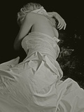 A Young Woman with Blonde Hair Wearing a White Dress Lying on the Floor Photographic Print by Martina Zancan