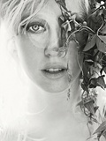 A Young Woman with Blonde Hair and Clear Eyes Photographic Print by Martina Zancan