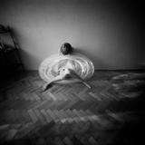 A Young Woman Sitting on a Pargued Floor Photographic Print by Rafal Bednarz