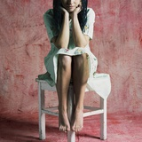 A Young Woman Sat on a Stool Photographic Print by Rafal Bednarz