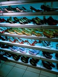 Shoes in a Shop Photographic Print by Jason Martin