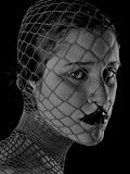 The Face of a Young Woman in a Net Photographic Print by Martina Zancan