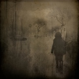 A Middle Aged Woman Walking Along a Street in Sepia Photographic Print by Eudald Castells