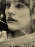 The Reflection of a Young Womans Face in a Broken Mirror Photographic Print by Martina Zancan