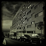A Dramatic View of a Block of Flats with Cars Photographic Print by Eudald Castells