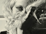 A Young Woman Hiding Behind Her Blonde Hair Photographic Print by Martina Zancan
