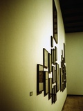 Picture Frames Hanging on a Wall Photographic Print by Jason Martin