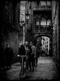 People Walking and Cycling on a Narrow Street Photographic Print by Eudald Castells