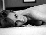 A Naked Young Woman with Freckles Lying on a Bed Photographic Print by Kenji Mizumori