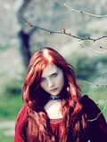 Young Woman with Red Hair Standing Outside Photographic Print by Elizabeth May