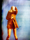 A Young Woman Wearing a Short Coat, Large Rimmed Hatand Long Brown Boots Photographic Print by Kenji Mizumori