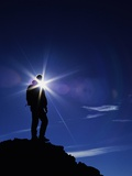 Colorado Hiker Silhouette with Lens Flare and Blue Sky Photographic Print by Kevin Lange