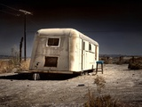 An Old White Caravan Left to Rot in the Desert Photographic Print by Jody Miller