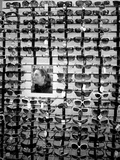 Wall of Sunglasses and Woman Reflection Photographic Print by Kevin Lange