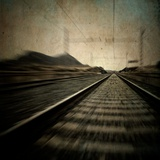 Train Travelling at Speed on a Railway Photographic Print by Luis Beltran