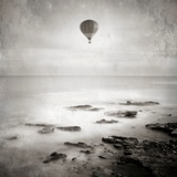 A Hot Air Balloon Floating Above the Sea Photographic Print by Luis Beltran