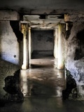 A Dark Wet Underground Hallway in Decay Photographic Print by Jody Miller