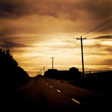 A Road with White Lines and Telephone Poles Photographic Print by Mark James Gaylard