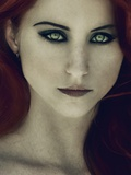 A Girl with Red Hair and Piercing Eyes Photographic Print by Elizabeth May