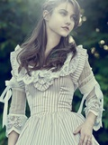 A Girl Looking to One Side Wearing a Victorian Striped Dress Photographic Print by Elizabeth May